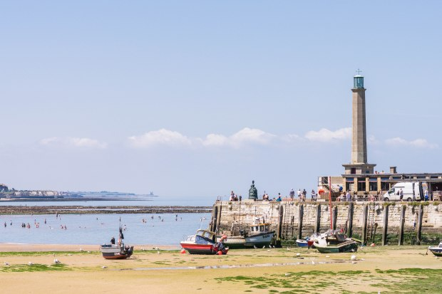 Margate harbour with Reculver Towers in the distance